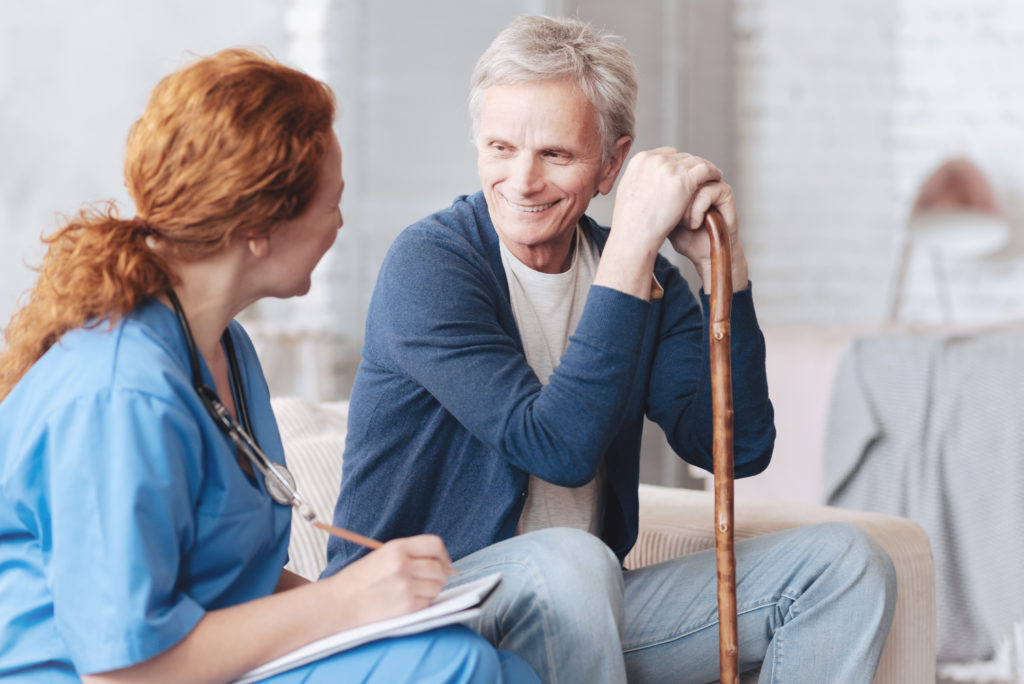 Older adult talking to nurse about moving to residential care